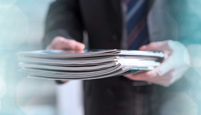 Man holding Stack of Papers